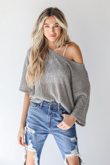 Grey - Model wearing a Loose Knit Top with jeans