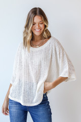 Ivory - Model wearing a Loose Knit Top with denim
