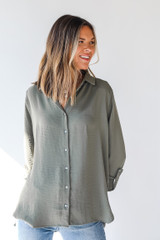 Model wearing a Button-Up Blouse