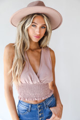 Blush - Model wearing a Smocked Tank with a wide brim hat
