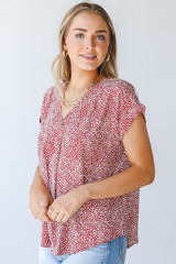 Rust - Model wearing a Spotted Blouse