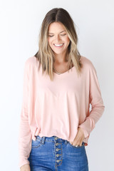 Blush - Dress Up model wearing an Everyday Tee with dark wash jeans