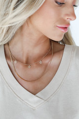 Model wearing a Gold Smiley Face Layered Necklace