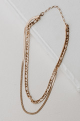 Flat Lay of a Gold Layered Chain Necklace