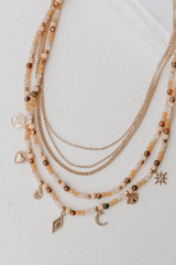 Peach - Flat Lay of a Beaded Layered Necklace
