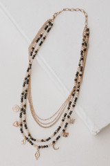 Flat Lay of a Beaded Layered Necklace in Black
