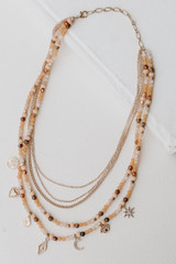 Flat Lay of a Beaded Layered Necklace in Peach