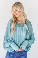 Teal - Dress Up model wearing a Blouse