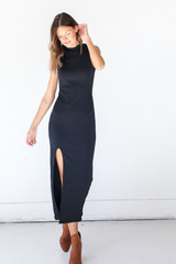 Model wearing a black Ribbed Maxi Dress with booties