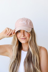 Model wearing the Dolly Script Embroidered Hat in Blush
