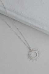 Silver - Flat Lay of a Sunburst Necklace