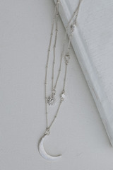 Silver - Flat Lay of a Celestial Layered Necklace