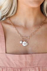 Model wearing a Gold Charm Necklace