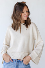Ivory - Model wearing a Sweater with jeans