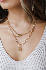 Model wearing a Gold Lock Layered Necklace