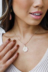 Model wearing a Gold Coin Necklace