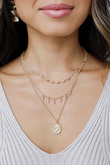 Model wearing a Gold Layered Coin Necklace