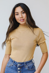 Gold - Dress Up model wearing a Mock Neck Sweater Top