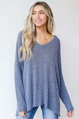 Blue - Model wearing an Oversized Knit Top with denim