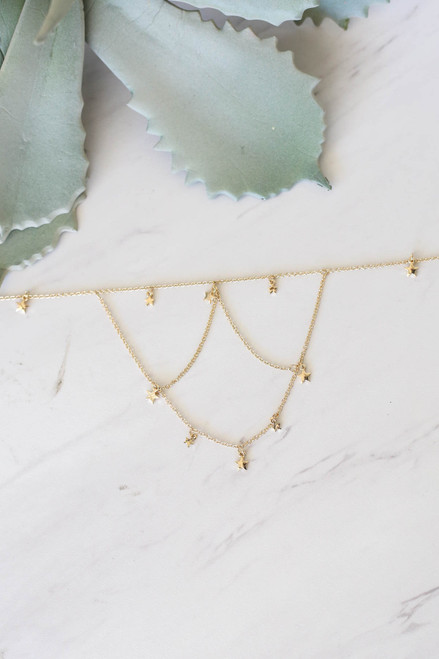 Gold - Tiered Star Necklace Flat Lay