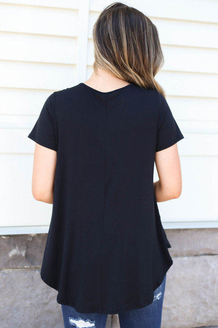 Model wearing Black Pocketed Babydoll Tee Back View