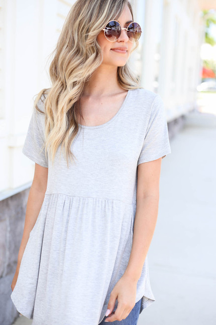 Model wearing Heather Grey Pocketed Babydoll Tee Front View