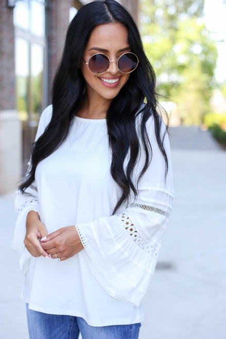 Model Wearing White Crochet Bell Sleeve Blouse Front View