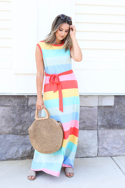 Model wearing Multi-Striped Belted Sleeveless Maxi Dress and Woven Tote
