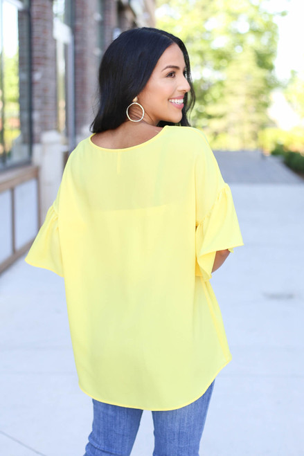 Model wearing Yellow Bell Sleeve Blouse Back View
