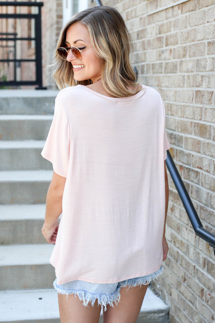 Model wearing Blush Relaxed Fit Pocketed Basic Tee Back View
