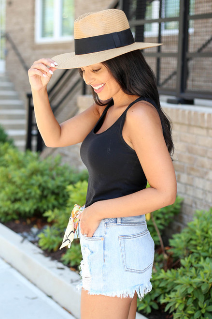 Model Wearing Light Wash Distressed Denim Shorts with Belt Side View