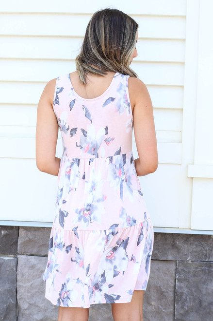 Model wearing Blush Tiered Button Up Floral Dress Back View