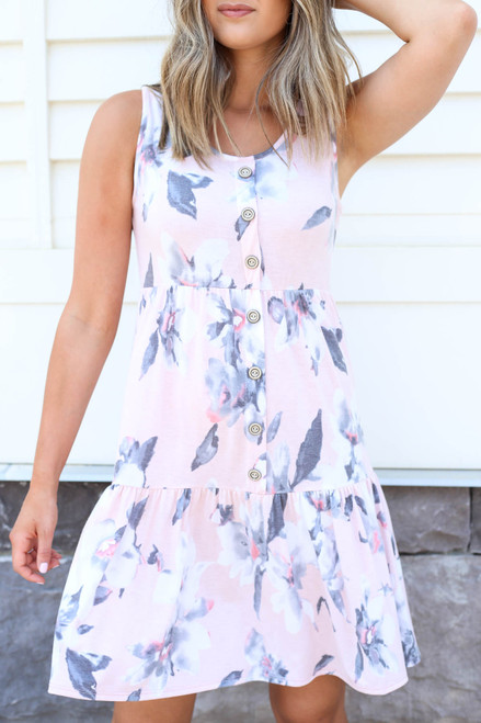 Model wearing Blush Tiered Button Up Floral Dress Detail View