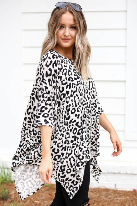 Model wearing White and Black Leopard Print Top Side View