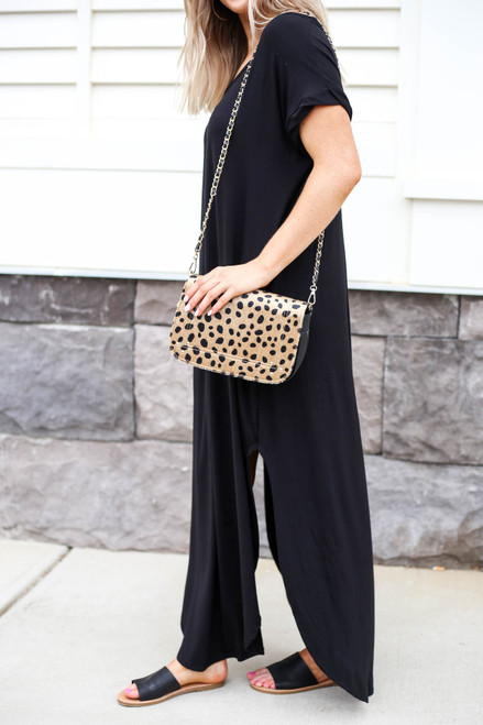 Model Carrying Cheetah Print Crossbody