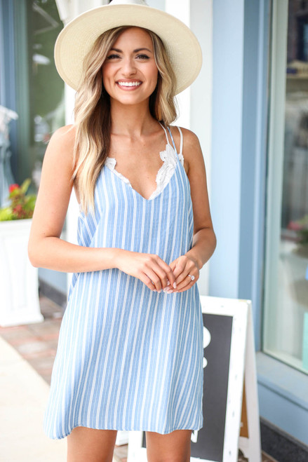 Model wearing Blue and White Striped Swing Dress