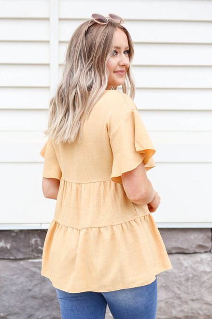 Model wearing Mustard Tiered Blouse Back View