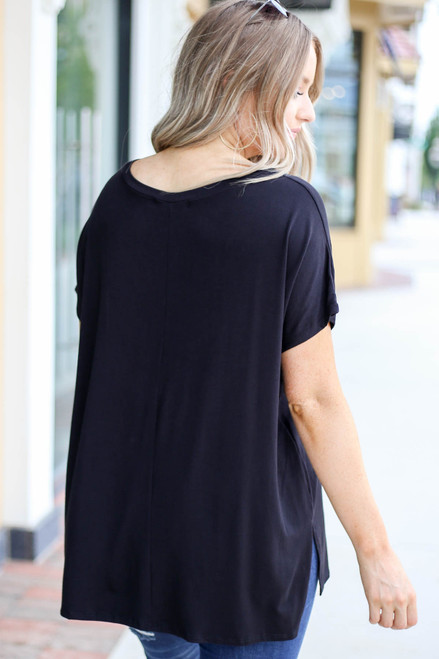 Model wearing Black Oversized V-Neck Tee Back View