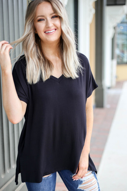 Model wearing Black Oversized V-Neck Tee