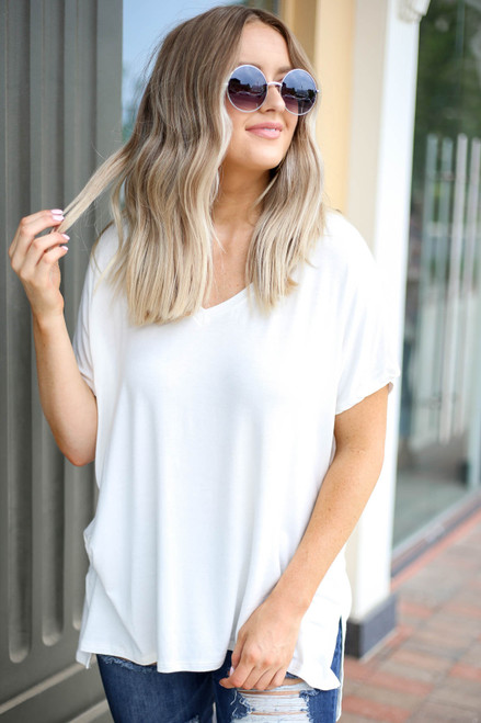 Model wearing Ivory Oversized V-Neck Tee