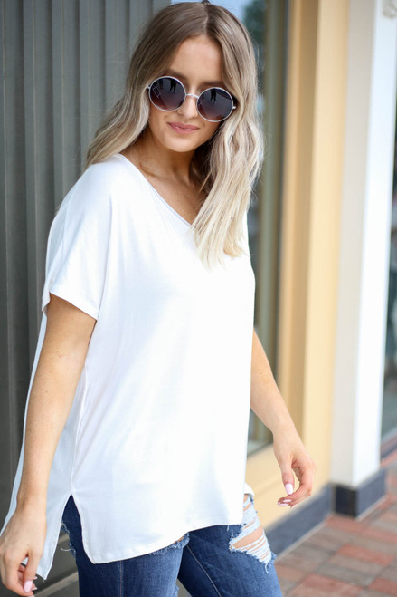 Model wearing Ivory Oversized V-Neck Tee Side View