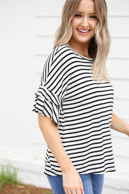 Model wearing White and Black Striped Ruffle Sleeve Tee Side View