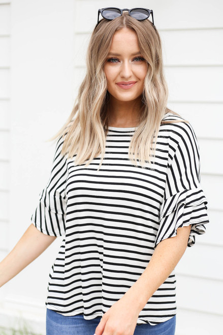 Model wearing White and Black Striped Ruffle Sleeve Tee Front View