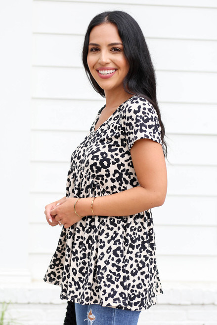 Model wearing Taupe Leopard Print Babydoll Top Side View