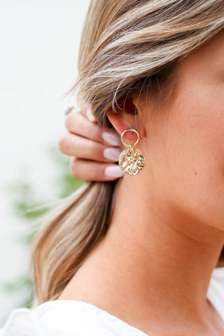 Gold Hammered Drop Earrings On Model