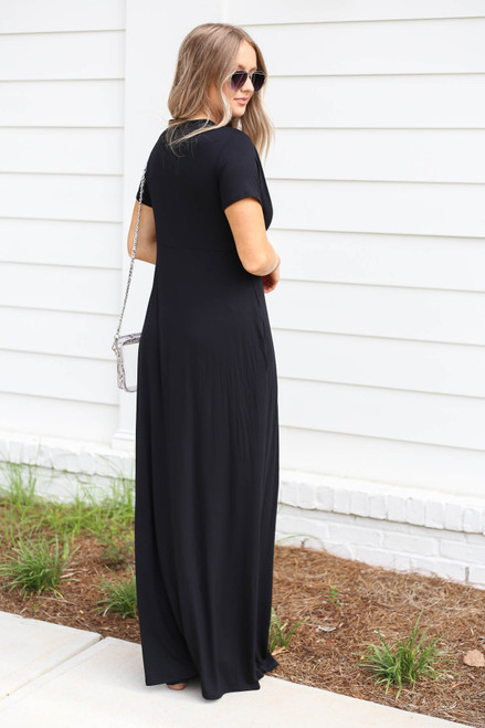 Model wearing Black Knotted Cotton Maxi Dress Back View