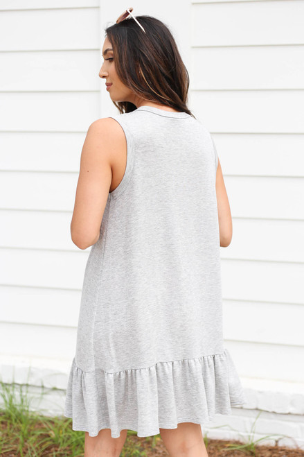 Model wearing Heather Grey Button Front Ruffle Dress Back View