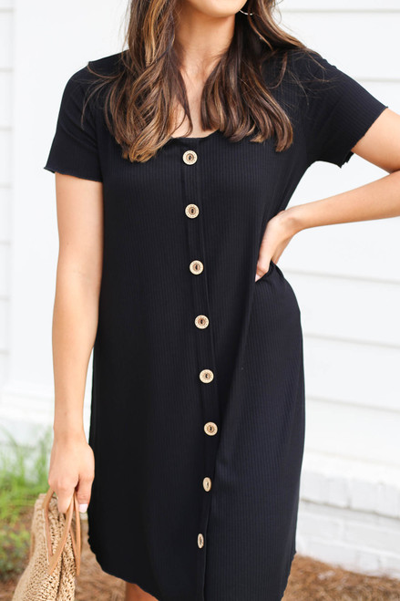 Model wearing Black Button Front Ribbed Mini Dress Detail View