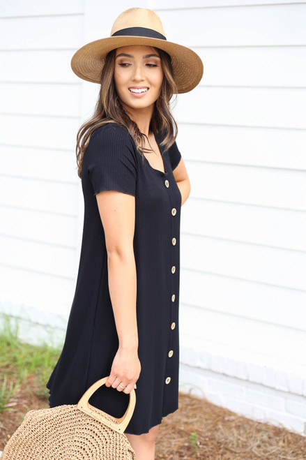 Model wearing Black Button Front Ribbed Mini Dress Side View