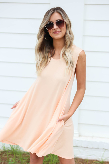 Model wearing Peach Pocketed Swing Dress Front View